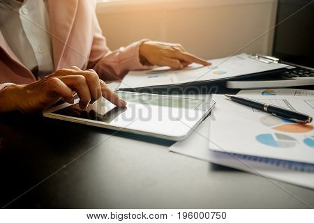 Business Woman Working At Office With Laptop And Documents On His Desk. Business Concept.