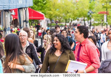 Montreal, Canada - May 27, 2017: Old Town Area With Closeup Of Crowd Of People Walking Up Street Lau