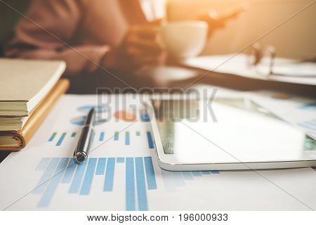 Business Concept With Copy Space. Office Desk Table With Pen Focus And Analysis Chart Computer Noteb