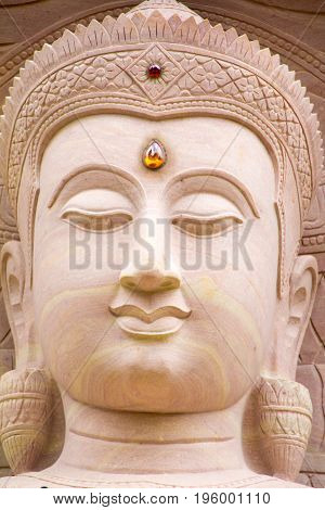 White stone carving buddha with naga at Wat Tai Phra Chao Yai Ong TueUbonratchathani ProvinceThailand.