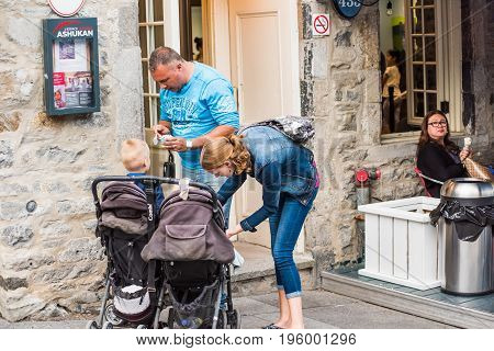 Montreal, Canada - May 27, 2017: Old Town Area With People Family With Children Eating Ice Cream Out