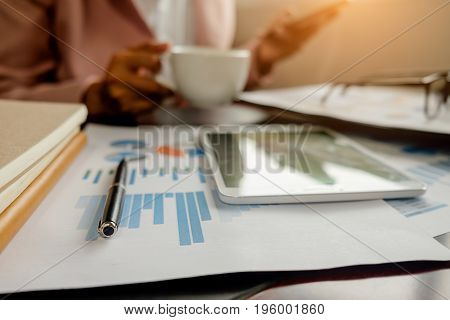 Office Desk Table With Pen, Keyboard On Notebook, Cup Of Coffee And Flower. Top View With Copy Space