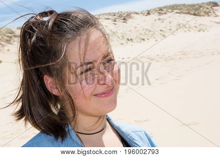 Close Up Portrait Of A Beautiful Teenager Woman On A Beach, Smiling And Looking At The Camera On Vac