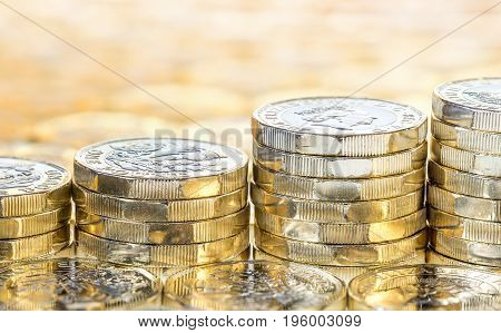 Ascending Stacks Of Gold Coins With Coins Background.