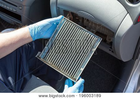 Replacing the old cabin air filter for car
