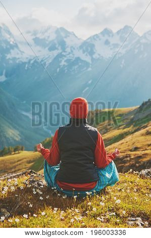 Woman Doing Exercise On The Top Of Mountain