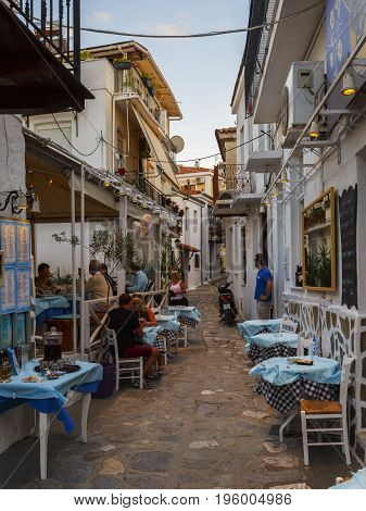SKIATHOS, GREECE - JUNE 18, 2017: Restaurant in the old town of Skiathos in Sporades, Greece on June 18, 2017.
