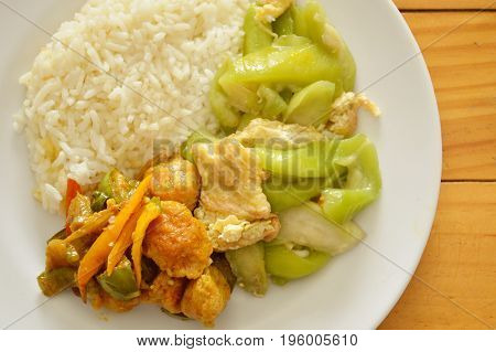 spicy stir fried fish ball and gourd with egg on rice