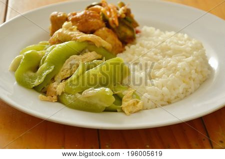 stir fried gourd with egg and spicy fish ball on rice