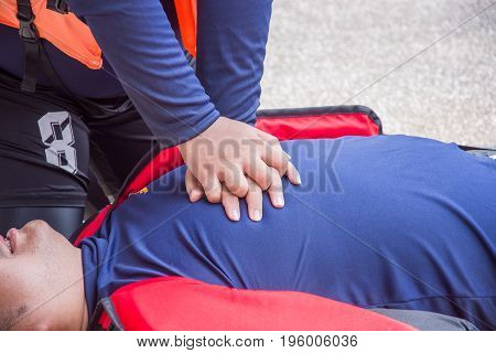 cpr training course and doing chest compression victim arrest drowning