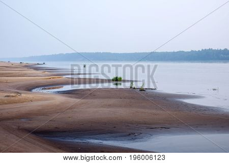 Sand Dunes Of A River Beach At Sunset