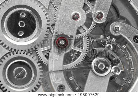 some different gears and wheels of a clockwork