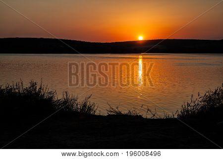 Photo of the setting sun lake Azure