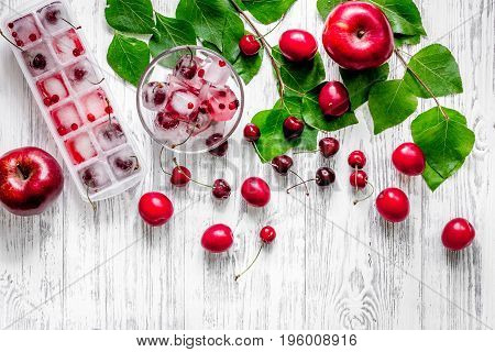 Fruits and berries for summer fruit drink on wooden table background top view