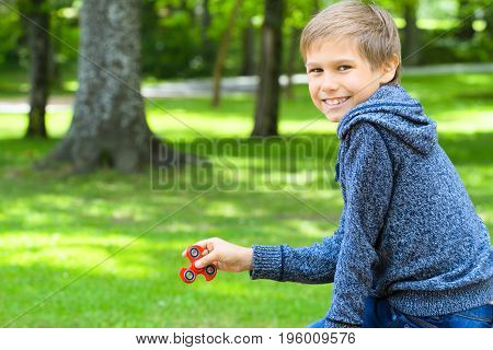 Child playing with a fidget spinner outdoors