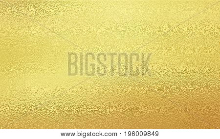 Shining gold foil. Yellow metal like texture background.
