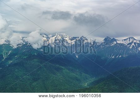 Landscape With Snow-covered Peaks Of The Caucasus Mountains And The Deep Gorge On A Summer Day