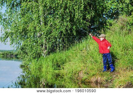 Boy Fishing In  Summer Morning