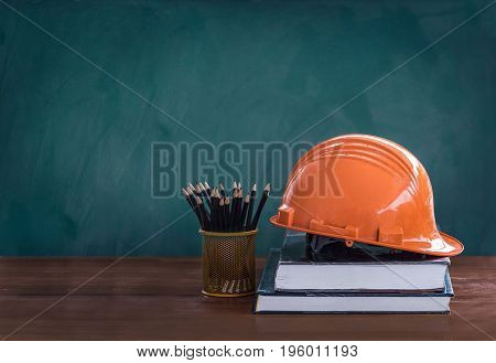 orange hard safety helmet hat for safety project of workman as engineer or worker. Education engineer concept