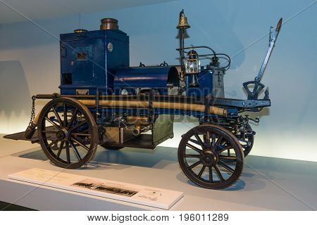 STUTTGART GERMANY- MARCH 19 2016: Daimler motorized fire-fighting pump (Daimler Motor-Feuerspritze) 1892. Mercedes-Benz Museum.
