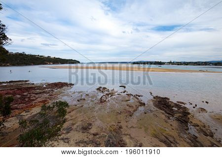 The iconic Boggy Creek providing an outlet to the ocean for Merimbula in New South Wales, Australia