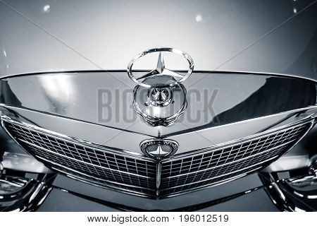 STUTTGART GERMANY- MARCH 19 2016: Fragment of full-size luxury car Mercedes-Benz 300 SEL 6.3 1972. Black and white. Mercedes-Benz Museum.