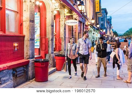 Montreal, Canada - May 27, 2017: Old Town Area With People Walking By Street In Evening Outside Rest