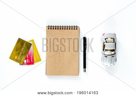 Choosing car concept. Toy cars on white background top view.