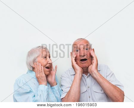 The elderly couple surprised by raising both hands at studio