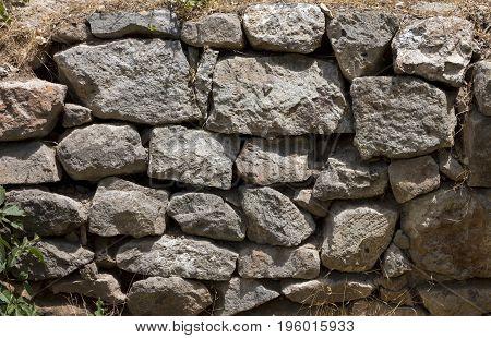 Old stonework in the sunlit in Armenia.