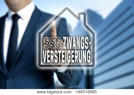 Zwangsversteigerung (in German Foreclosure) Touchscreen Is Operated By Businessman
