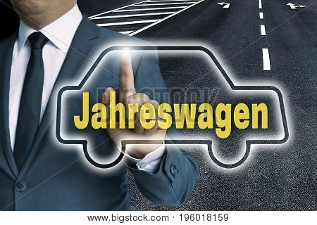 (in German Year Car) Car Touchscreen Is Operated By Man Concept