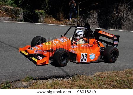 Malvaro Favale Italy - July 16 2017: Uphill Race Race Favale Castello: The F1 racing car type L.R. Conducted Roberto Loda in action on the path.