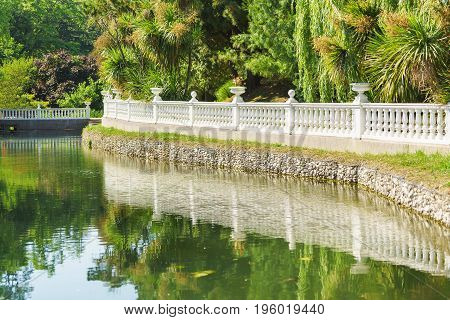 Beautiful Balustrade And Its Reflection In The Pond Of City South Park
