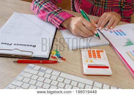 Female Studying Plans In Office. Business woman working at the office. calculating or checking balance. Business plan finances investment economy saving money or insurance concept