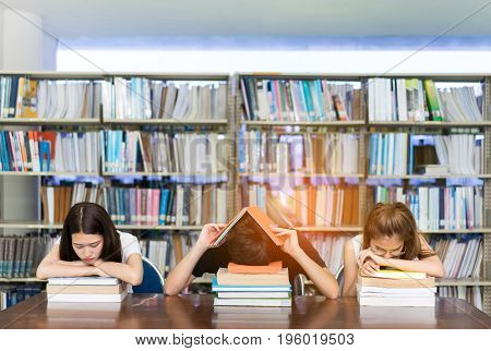 Young Student Group seriously with Her Exam and reading book in Library