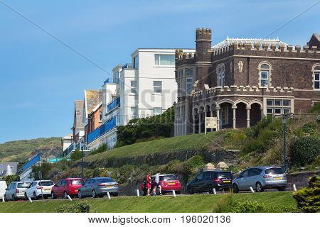 Woolacombe Devon England 14 July 2016: Hotels by the sea near the popular beach of Woolakomb. Cars are parked nearby. Devon. England