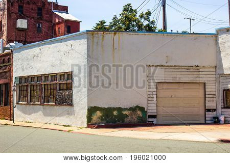 Abandoned Building In Disrepair With Boarded Up Windows