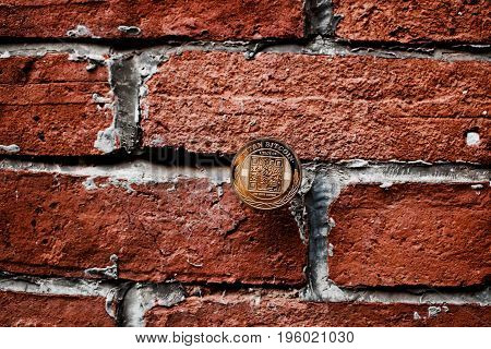 Digital currency physical gold titan bitcoin coin on the brick wall. poster