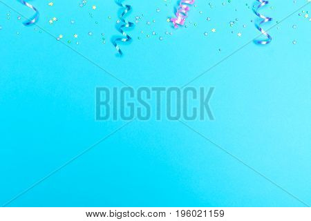 Party theme in blue and purple with streamers