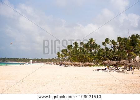 View Of The Sandy Beach In Punta Cana, La Altagracia, Dominican Republic. Copy Space For Text.