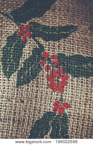 Top view of Sack of coffee beans Screen picture coffee tree and red seed Colour retro style Thailand
