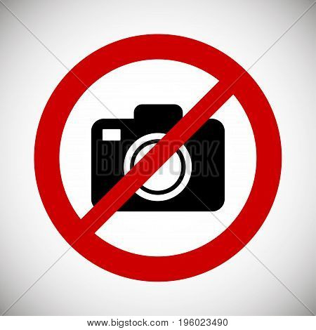 Camera in red ban on a white background. No photography