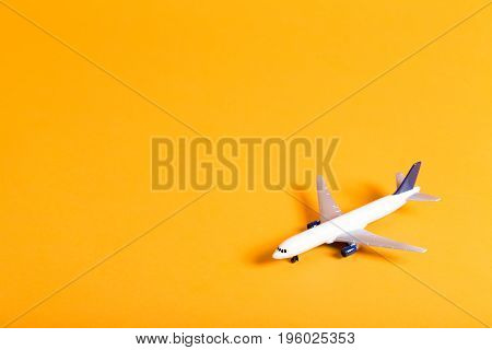 Miniature airplane travel theme on a bright background