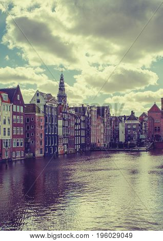 Amsterdam Canal Singel With Typical Dutch Houses  Holland, Netherlands.
