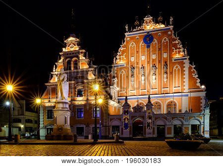City Hall Square With House Of The Blackheads In Old Town Of Riga In The Night, Latvia