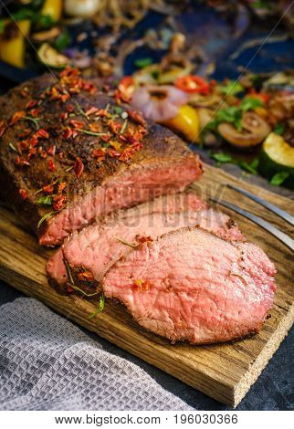A Grilled Pepper Steak Garnished Fresh Herbs