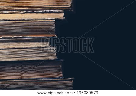 Pile of hardcover book with space for your text.