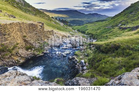 Scenic Mountain Creek Waterfall in Snowdonia National Park