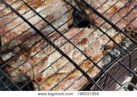 Cooking of pork loin on a grill